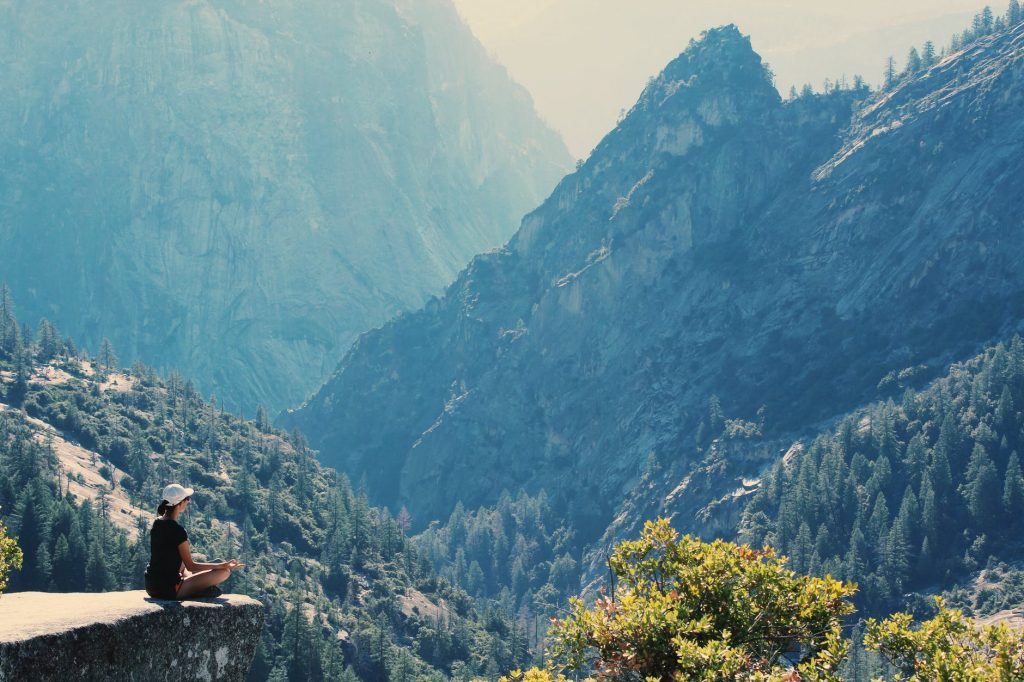 photography of a woman meditating